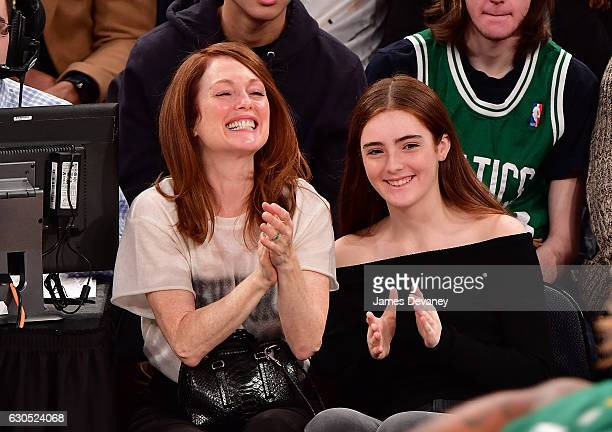 Julianne Moore and Liv Freundlich attend Boston Celtics Vs New York Knicks game at Madison Square Garden on December 25 2016 in New York City