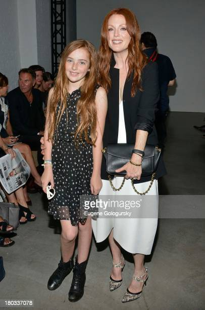 Julianne Moore and Liv Freundlich attend the Reed Krakoff show during Spring 2014 MercedesBenz Fashion Week at 545 West 22nd Street on September 11...
