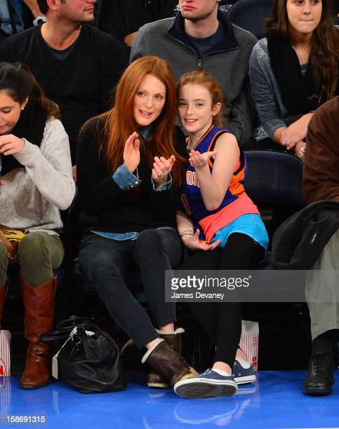 Julianne Moore and Liv Helen Freundlich attend the Minnesota Timberwolves vs New York Knicks game at Madison Square Garden on December 23 2012 in New...