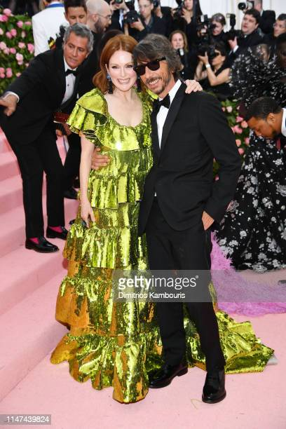 Julianne Moore and Pier Paolo Piccioli attend The 2019 Met Gala Celebrating Camp Notes on Fashion at Metropolitan Museum of Art on May 06 2019 in New...