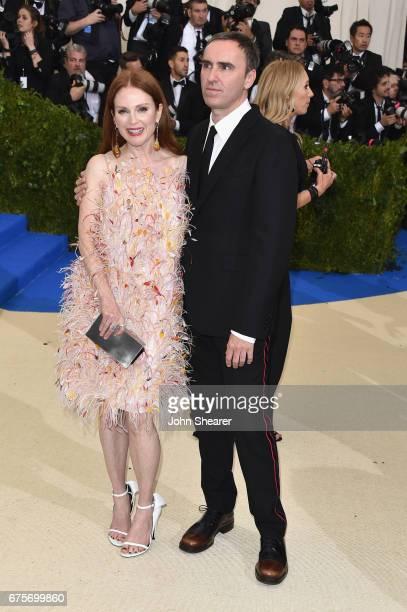 Julianne Moore and Raf Simons attend the 'Rei Kawakubo/Comme des Garcons Art Of The InBetween' Costume Institute Gala at Metropolitan Museum of Art...