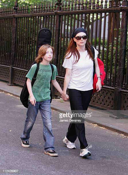 Julianne Moore and son Cal during Julianne Moore and Son Cal Sighting on Set of 'Revolutionary Road' May 30 2007 at Streets of Manhattan in New York...