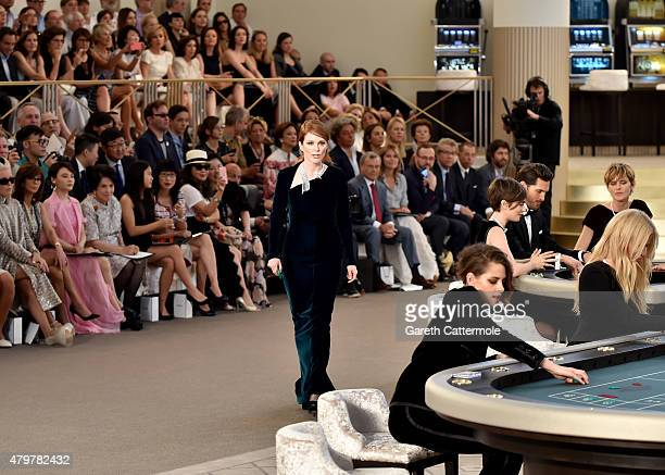 Julianne Moore Kristen Stewart and Lara Stone attend the Chanel show as part of Paris Fashion Week Haute Couture Fall/Winter 2015/2016 at the Grand...