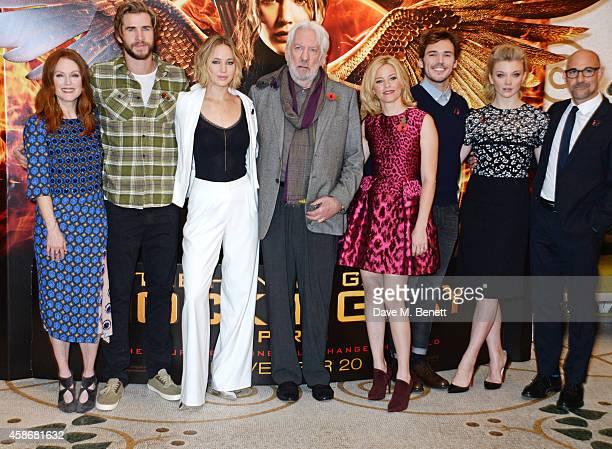 Julianne Moore Liam Hemsworth Jennifer Lawrence Donald Sutherland Elizabeth Banks Sam Claflin Natalie Dormer and Stanley Tucci attend a photocall for...