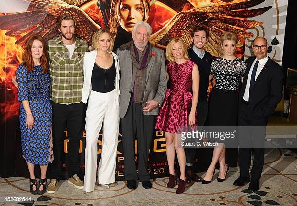 Julianne Moore Liam Hemsworth Jennifer Lawrence Donald Sutherland Elizabeth Banks Sam Claflin Natalie Dormer and Stanley Tucci attend the photocall...