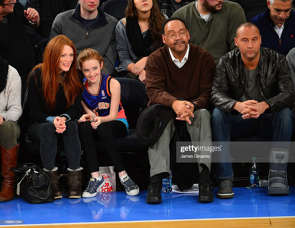 Julianne Moore, Liv Helen Freundlich, Sanderson Jeter and Derek Jeter attend the Minnesota Timberwolves vs New York Knicks game at Madison Square Garden on December 23, 2012 in New York City.