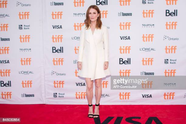 Julianne Moore poses for photographers at the premiere of 'Suburbicon' at the Toronto International Film Festival in Toronto Ontario September 9 2017...