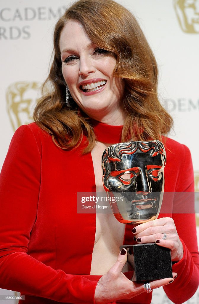 Julianne Moore poses in the winners room with the Leading Actress Award for 'Still Alice' at the EE British Academy Film Awards at The Royal Opera House on February 8, 2015 in London, England.