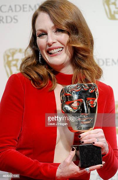 Julianne Moore poses in the winners room with the Leading Actress Award for 'Still Alice' at the EE British Academy Film Awards at The Royal Opera...