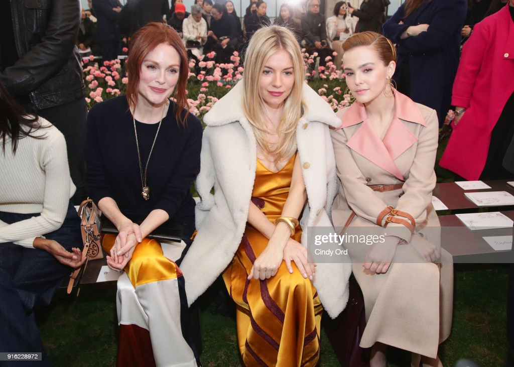 Julianne Moore, Sienna Miller, and Zoey Deutch attend the Tory Burch Fall Winter 2018 Fashion Show during New York Fashion Week at Bridge Market on February 9, 2018 in New York City.