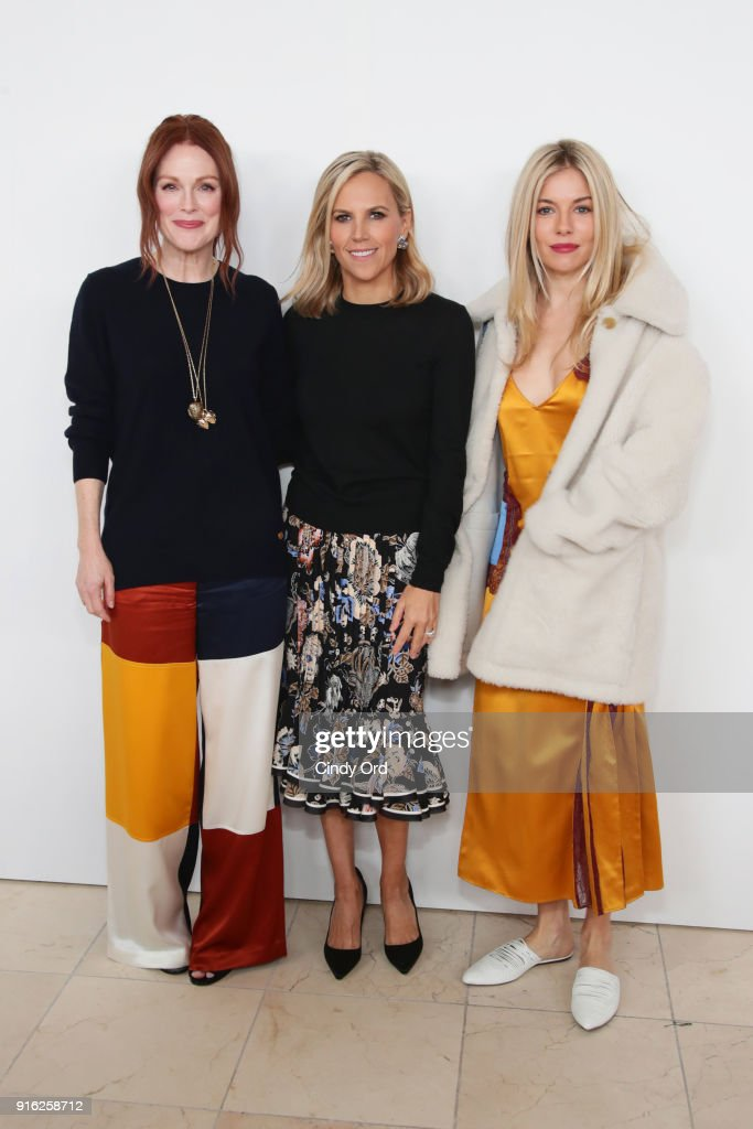 Julianne Moore, Tory Burch, and Sienna Miller attend the Tory Burch Fall Winter 2018 Fashion Show during New York Fashion Week at Bridge Market on February 9, 2018 in New York City.