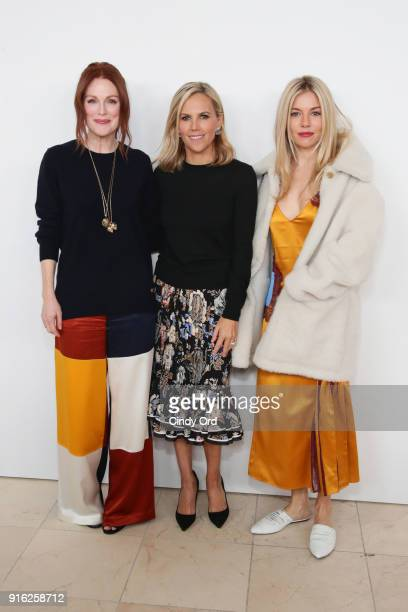 Julianne Moore Tory Burch and Sienna Miller attend the Tory Burch Fall Winter 2018 Fashion Show during New York Fashion Week at Bridge Market on...