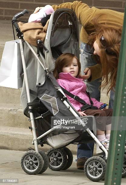 Julianne Moore walks with her twoyearold daughter Liv Helen Freundlich in midtown October 24 2004 in New York City