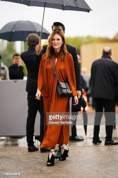 Julianne Moore wears a frilly collar rustcolor pleated dress a Dior bag outside Dior during Paris Fashion Week Womenswear Spring Summer 2020 on...