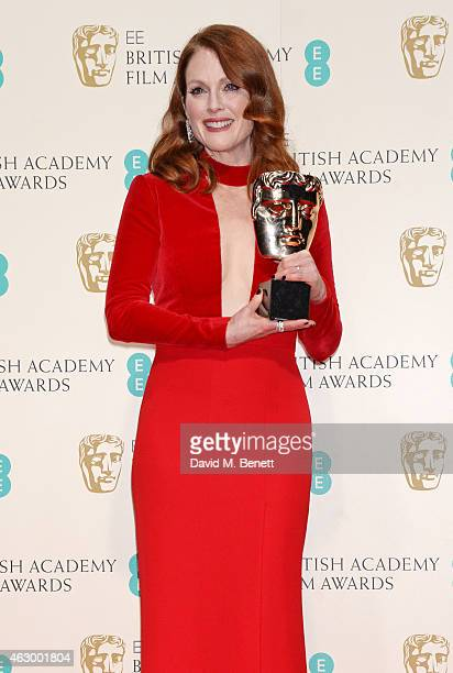 Julianne Moore winner of the Leading Actress award for Still Alice poses in the winners room at the EE British Academy Film Awards at The Royal Opera...