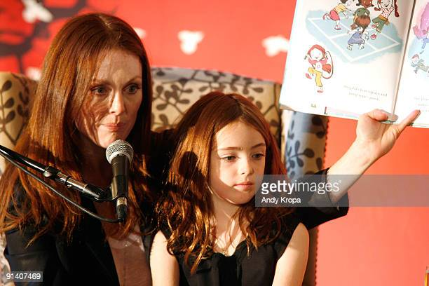 Julianne Moore with her daughter Liv Freundlich reads to children during 'Make it Matter Day' in support of literacy and education at The New York...