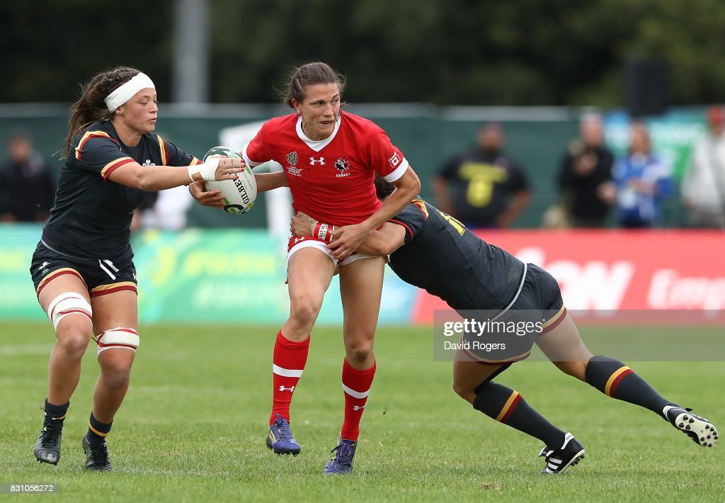 Julianne Zussman of Canada is tackled by Alisha Butchers (L) and Gemma Rowland (R) of Wales during the Women's Rugby World Cup 2017 match between Canada and Wales on August 13, 2017 in Dublin, Ireland.