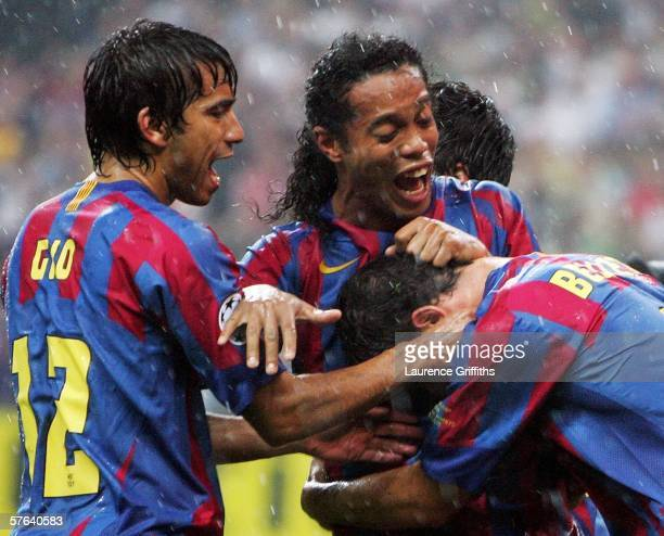 Juliano Belletti of Barcelona celebrates scoring his teams second goal with Ronaldinho and Giovanni Van Bronckhorst during the UEFA Champions League...