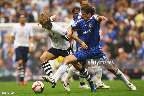 Juliano Belletti of Chelsea challenges Luka Modric of Tottenham Hotspur for the ball during the Barclays Premier League match between Chelsea and...