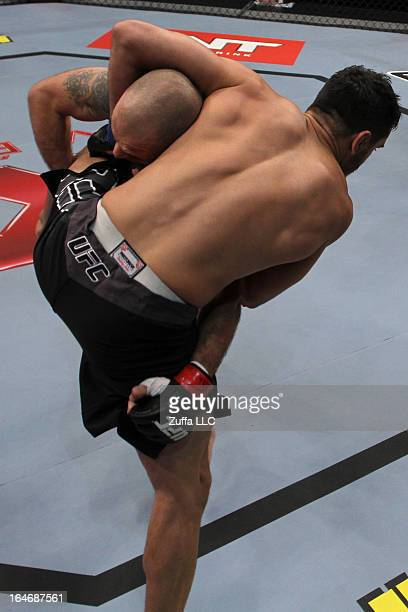 """Juliano """"Ninja"""" Wandalen atempts a takedown against Henrique """"Sucuri"""" Vasconcelos in their elimination fight during filming of season two of The..."""