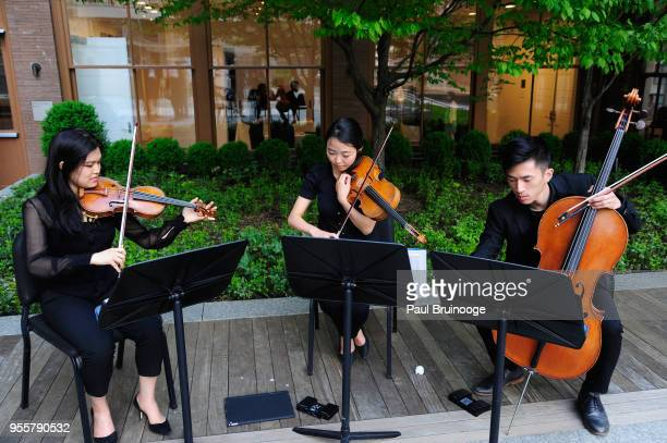 Juliard string trio plays during the 2018 Change Maker Awards at Carnegie Hall on May 7 2018 in New York City