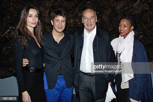 Julie Abdessemed her husband Adel Abdessemed Writer Tahar ben Jelloun and Jemina pose in front Who's afraid of the big bad wolf of Adel Abdessemed...
