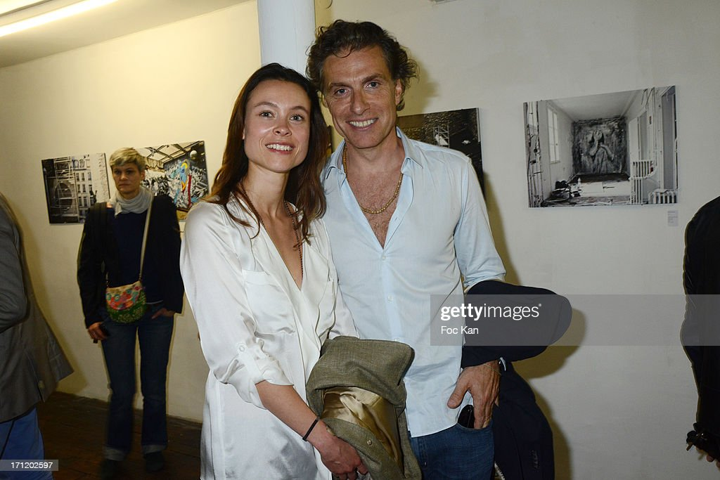 Julie Acroute from Oola Productions and Jean Pierre Marois attend 'Les Bains Residence d'Artistes' Exhibition Preview And Book Launch at the Galerie Magda Danysz on June 22, 2013 in Paris, France.