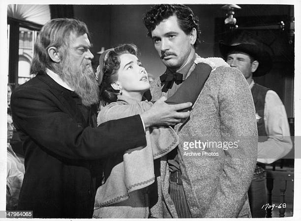 Julie Adams holding onto Rock Hudson in a scene from the film 'The Lawless Breed' 1953