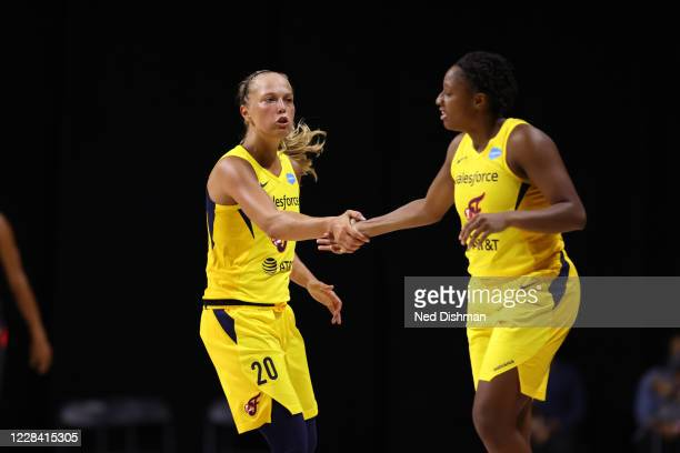 Julie Allemand of the Indiana Fever shigh fives her teammate during the game against the Las Vegas Aces on September 8, 2020 at Feld Entertainment...
