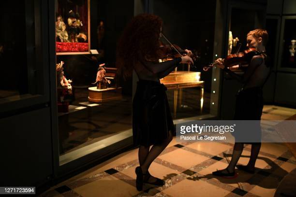 Julie and Camille Berthollet, the Automate characters play musique at Conservatoire National des Arts et Métiers on July 26, 2020 in Paris, France....