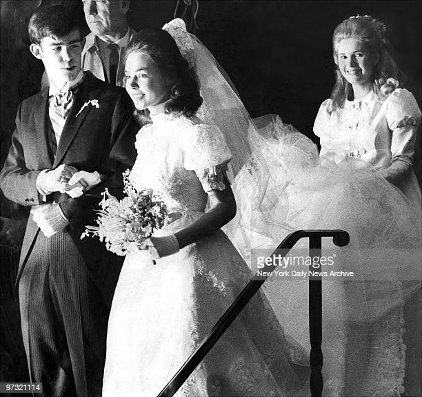 Julie and David Eisenhower leaving Marble Collegiate Church with Tricia Nixon, maid of honor, following their wedding