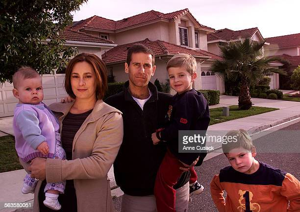 Julie and Marc Rashba with their three children Talia 8 months Gabriel age 4 and Noah age 6 stand in front of their home at 220 St Thomas Drive in...