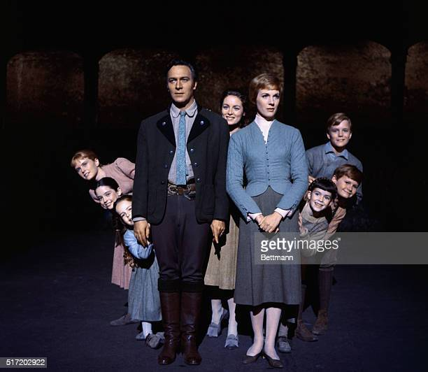 Julie Andrews and Christopher Plummer are flanked on all sides by their children all members of the singing Von Trapp family in this publicity...