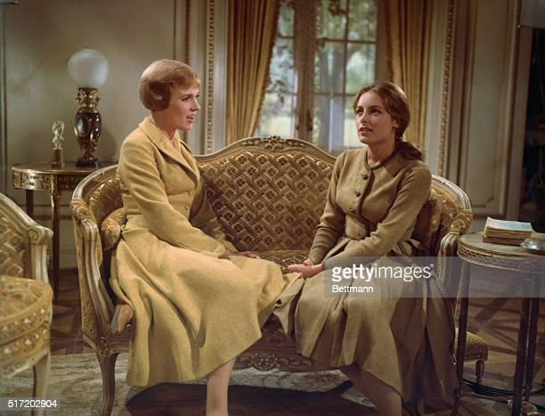 Julie Andrews as Maria von Trapp sits on a sofa with Charmian Carr as Liesl von Trapp in the film adaption of the Rogers and Hammerstein musical The...