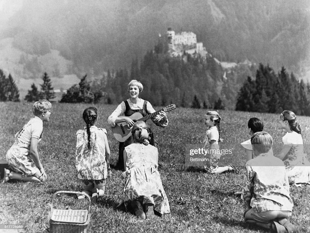 Julie Andrews portrays Maria von Trapp in a scene from the popular movie musical of 1965, The Sound of Music. Acting as the governess, she sings to her charges while sitting in a pasture.