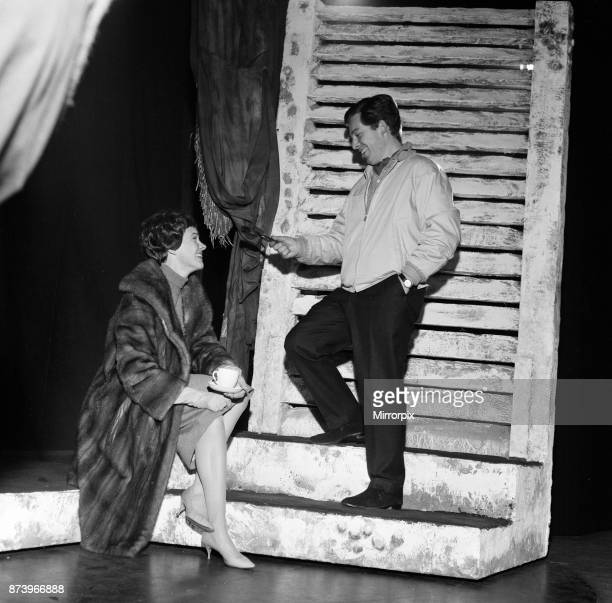 Julie Andrews watches her husband Tony Walton working on stage at the Lyric Theatre, Hammersmith. He is the stage and costume designer in William...