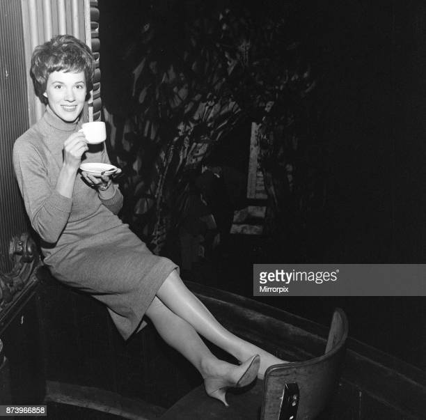 Julie Andrews watches her husband working on stage at the Lyric Theatre, Hammersmith. He is the stage and costume designer in William Brach's play 'A...