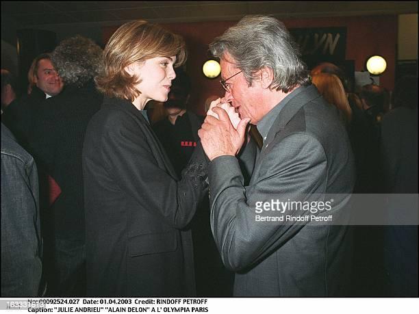 Julie Andrieu Alain Delon at the Olympia of Paris man woman hugging