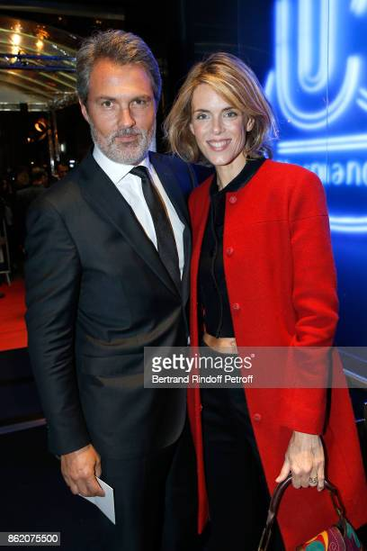 Julie Andrieu and her husband Stephane Delajoux attend the Knock Paris Premiere at Cinema UGC Normandie on October 16 2017 in Paris France