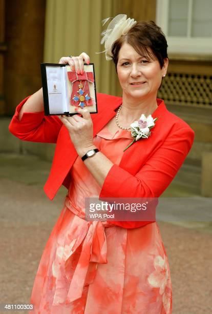 Julie Bailey holds her CBE Award after being presented with it by Queen Elizabeth II at an Investiture ceremony at Buckingham Palace on March 28 2014...