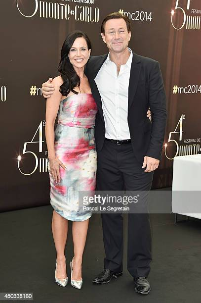 Julie Benz and Grant Bowler attend a photocall at Grimaldi forum on June 9, 2014 in Monte-Carlo, Monaco.