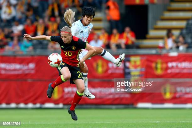 Julie Biesmans of Belgium and Yu Nakasato of Japan go up for a header during the Women's International Friendly match between Belgium and Japan at...
