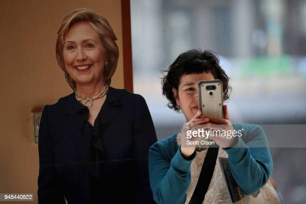 Julie Blackman takes a selfie with a cardboard cutout of Former Secretary of State Hillary Clinton at the Idas Legacy Fundraiser Luncheon on April 12...