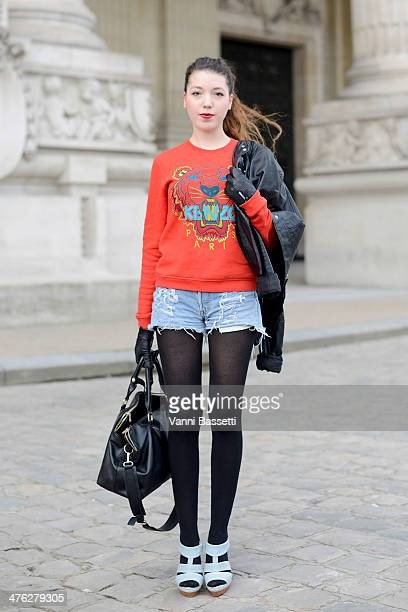 Julie Boilevin wears Kenzo sweater HM jacket Levi's shorts Andre shoes and Zara bag before Chloe show at the Grand Palais on March 2 2014 in Paris...