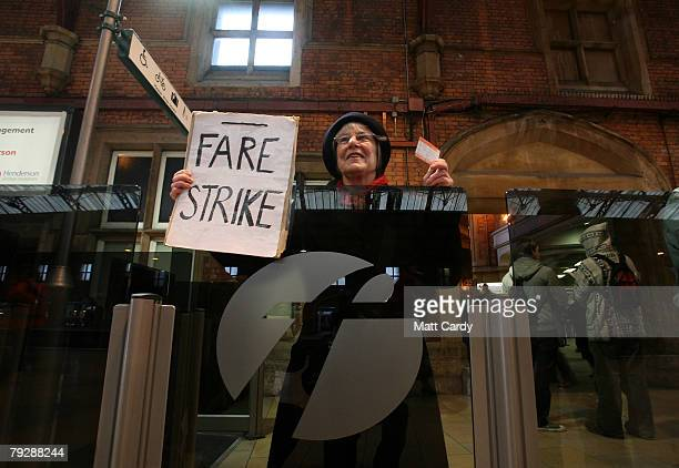 Julie Boston a commuter protester holds a placard urging passengers to take a fare strike on January 28 2008 in Bristol United Kingdom Rail commuters...