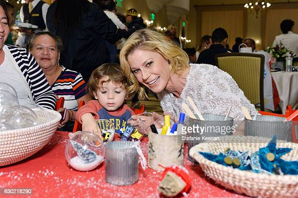 Julie Bowen and guest attend Baby2Baby Holiday Party Presented By Old Navy at Montage Beverly Hills on December 18 2016 in Beverly Hills California