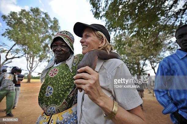 US Julie Boyd from Seattle WA is welcomed to Nyang'oma village in Kogelo January 19 2009 by elder Patricia Okinda during festivities on the eve of...