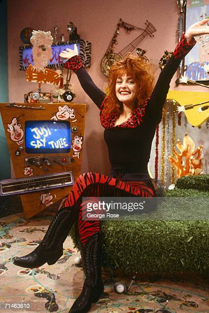 """Julie Brown, comedian and host of MTV's """"Just Say Julie"""" show, poses during a 1989 Hollywood, California, photo portrait session. Brown was riding..."""