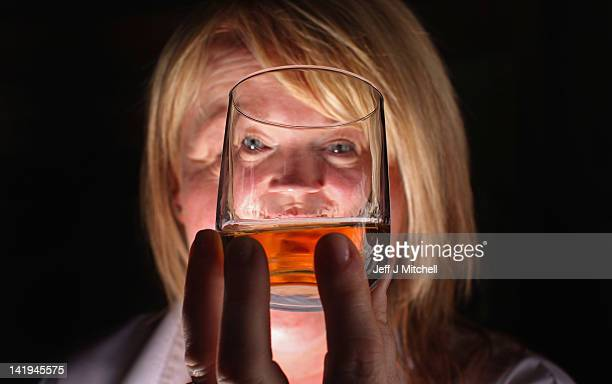 Julie Cameron tour guide holds a glass of whisky at Edradour distillery on March 26 2012 in Pitlochry United Kingdom Latest figures show exports of...