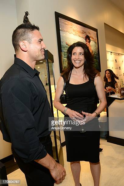 Julie Candice attends a gallery exhibit of Terry O'Neill Presents The Opus A 50 Year Retrospective at Mouche Gallery on June 19 2013 in Beverly Hills...